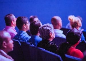 Photo of people watching a movie.