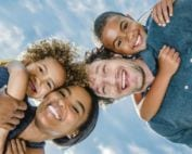 Multiracial family of four - wife, husband, son, daughter