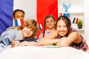 Photo of young students learning French