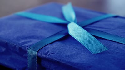 Photo of a blue gift-wrapped box