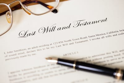 Photo of reading glasses and Last Will and Testament document