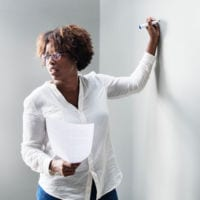 Photo of African-American teacher at a whiteboard