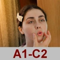 Photo of French student learning how to pronounce word.
