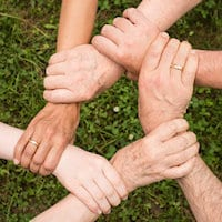 Photos of hands clasped around each others' wrists to help out