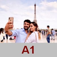 Photo of young couple taking selfie in front of Eiffel Tower in Paris